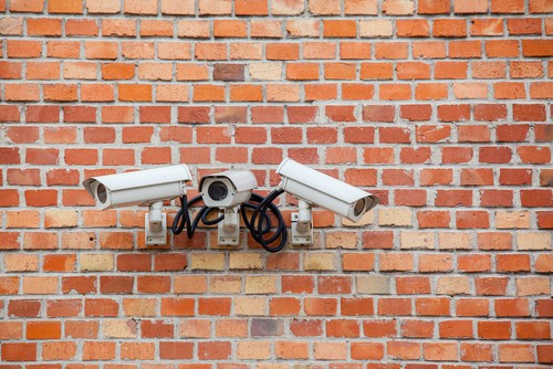 3 CCTV cameras on brick wall